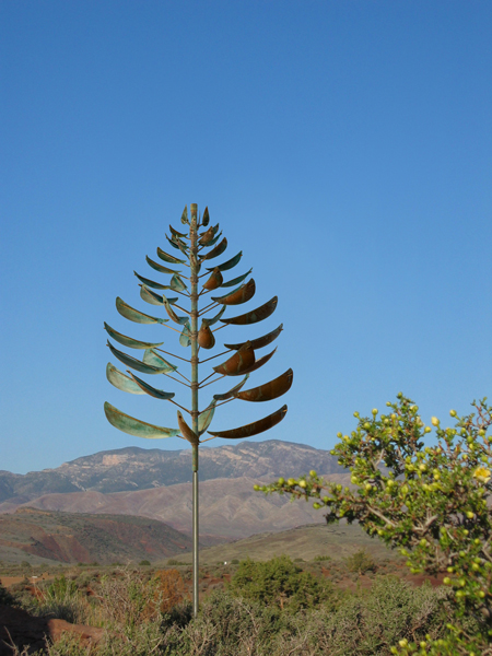 Ponderosa-Lyman-Whitaker-Wind-Sculpture-blue-sky