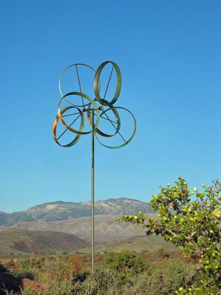 Shamrock-Lyman-Whitaker-Wind-Sculpture-blue-sky