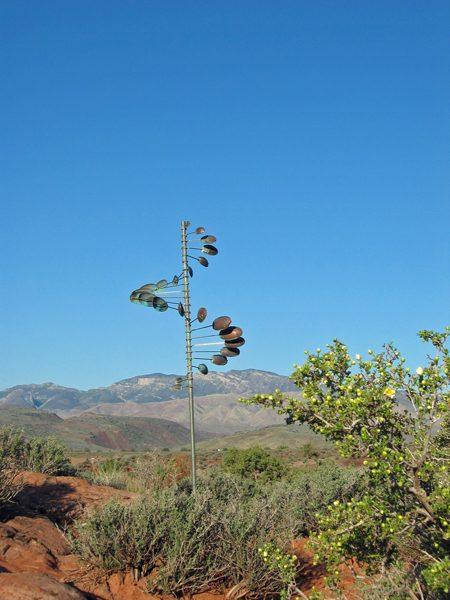 Single-Helix-Oval-Wind-Sculpture-by-Lyman-Whitaker-blue-sky