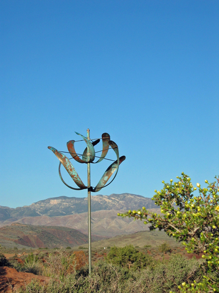 Windflower-Wind-Sculpture-by-Lyman-Whitaker--blue-sky